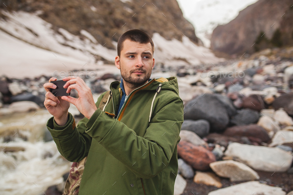 young hipster man hiking in mountains, winter vacation - Stock Photo - Images