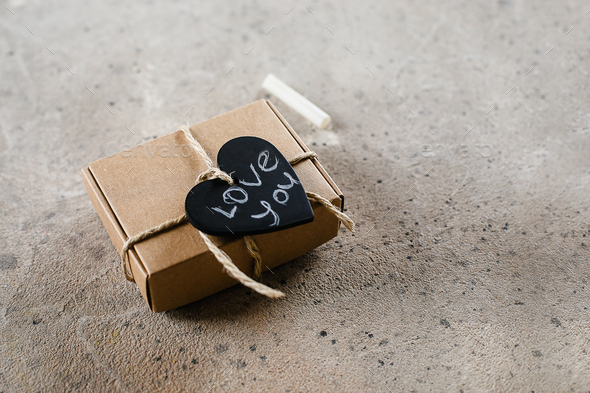 Gift Eco friendly Present box with heart and text Love you. Valentine's Day concept. Copy space - Stock Photo - Images