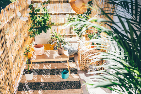 Eco friendly bamboo terrace. Orange pillows on the floor. - Stock Photo - Images