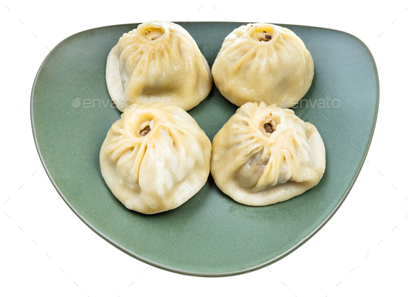 four steamed Buuz on green plate isolated - Stock Photo - Images