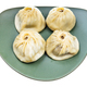 four steamed Buuz on green plate isolated - PhotoDune Item for Sale