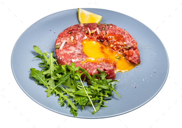 served Steak tartare on blue plate isolated - Stock Photo - Images