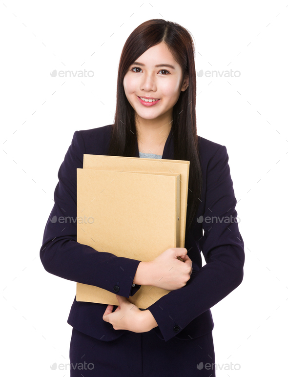Young businesswoman hand hold with folder - Stock Photo - Images