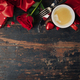 Valentine's day background with fresh cup of coffee, red roses, chocolate, fork, knife and gifts. - PhotoDune Item for Sale