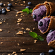Wafer cones with blackberry icecream on wooden kitchen table with crumbs and berries aside - PhotoDune Item for Sale