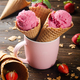 Wafer cones with strawberry icecream in pink mug on wooden kitchen table - PhotoDune Item for Sale