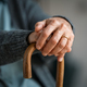 Old woman hands holding walking stick - PhotoDune Item for Sale