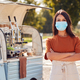 Portrait Of Woman Wearing Face Mask Running Independent Mobile Coffee Shop Standing Next To Van - PhotoDune Item for Sale