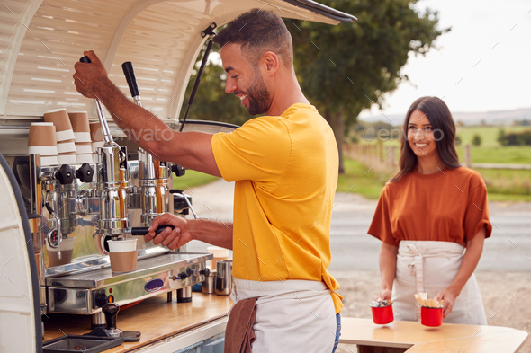 Couple Running Independent Mobile Coffee Shop Preparing Drink Standing Outdoors Next To Van - Stock Photo - Images