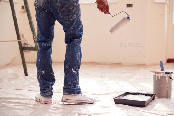 Close Up Of Man With Paint Roller Decorating New Home - Stock Photo - Images