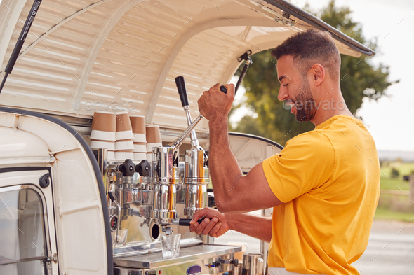 Man Running Independent Mobile Coffee Shop Preparing Drink Standing Outdoors Next To Van - Stock Photo - Images