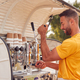 Man Running Independent Mobile Coffee Shop Preparing Drink Standing Outdoors Next To Van - PhotoDune Item for Sale