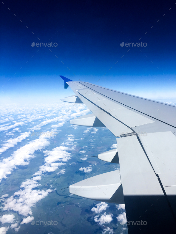 Airplane wing in the sky - Stock Photo - Images