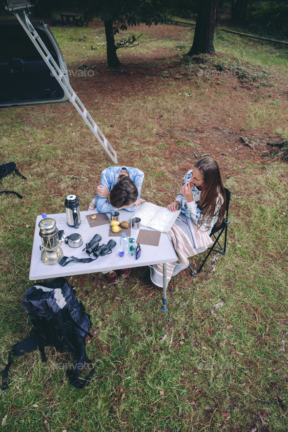 Young women having breakfast in a campsite - Stock Photo - Images