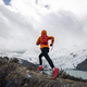 RunningWoman trail runner cross country running up to winter snow mountain top - PhotoDune Item for Sale