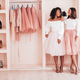 Portrait of two young beautiful women posing in pink wardrobe - PhotoDune Item for Sale