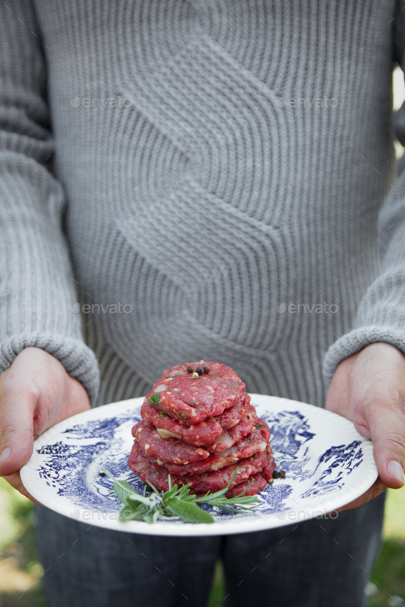 Man hands with burgers - Stock Photo - Images