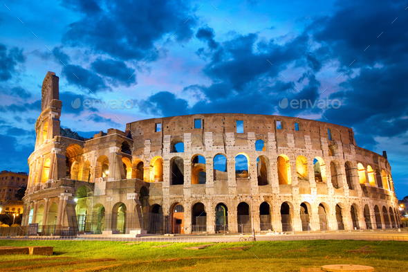 Colosseum or Coliseum in Rome at dusk, Italy - Stock Photo - Images