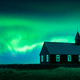Aurora borealis Northern lights over famous picturesque black church - PhotoDune Item for Sale