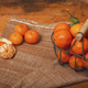 Fresh tangerines in a metal basket on a wooden background - PhotoDune Item for Sale