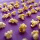 Popcorn closeup isolated on purple background - PhotoDune Item for Sale