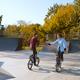 Two bmx bikers, training on ramp in skatepark - PhotoDune Item for Sale