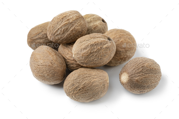 Heap of whole dried nutmeg seeds isolated on white background - Stock Photo - Images