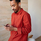 Concentrated young pretty bearded dark skinned brunette guy holding mobile phone - PhotoDune Item for Sale