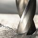 Close-up metal drilling process - PhotoDune Item for Sale