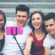 Group of friends with mobile phone on selfie stick and taking picture - PhotoDune Item for Sale