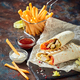 Eastern traditional shawarma, and French fries with sauces on slate - PhotoDune Item for Sale