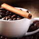 Cup with coffee beans and cinnamon stick - PhotoDune Item for Sale