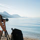 Young woman  taking photos of beautiful morning sea - PhotoDune Item for Sale