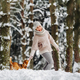 a woman on a walk with her dog in the winter forest. mistress and dog game in the snowy forest - PhotoDune Item for Sale