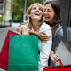 Shopping and tourism concept. Beautiful women friends with shopping bags in ctiy - PhotoDune Item for Sale