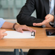 Customer signs a home loan agreement with a bank representative. - PhotoDune Item for Sale
