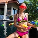sexy woman in colorful bikini playing having fun at summer summer pool on vacation in Thailand - PhotoDune Item for Sale