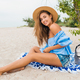 stylish beautiful smiling woman sitting on sand - PhotoDune Item for Sale