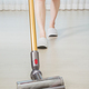 cleaning floor with cordless vacuum cleaner - PhotoDune Item for Sale