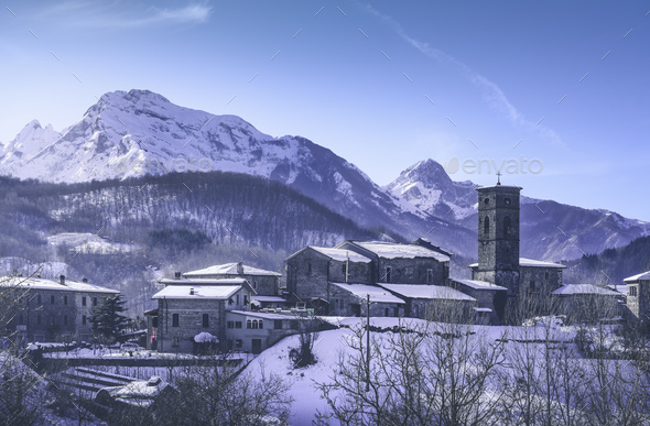 Piazza al Serchio snowy village and Apuan mountains in winter. Garfagnana, Tuscany, Italy - Stock Photo - Images