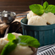 Vanilla icecream balls in clay bowls on wooden kitchen table with ice cream scoop aside - PhotoDune Item for Sale