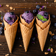 Flat lay view at wafer cones with blackberry icecream on wooden kitchen table - PhotoDune Item for Sale