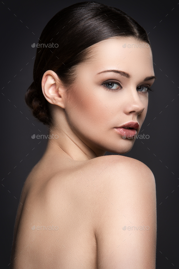 Beautiful girl on a gray background - Stock Photo - Images