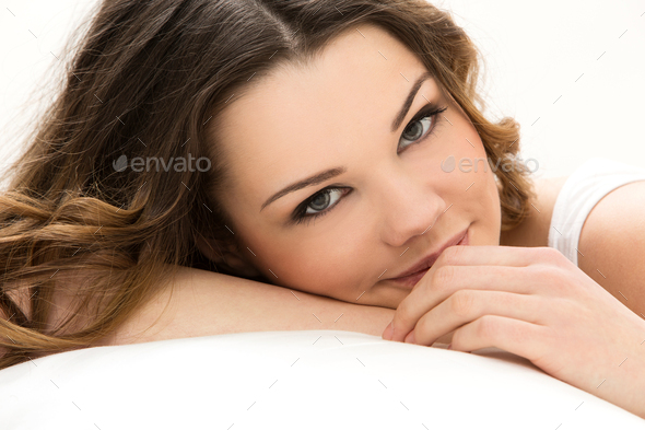 Beautiful girl in the bed - Stock Photo - Images