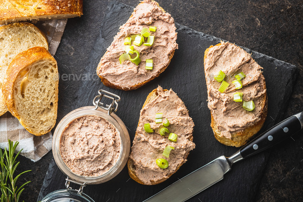 Liver pate on sliced baguette. - Stock Photo - Images