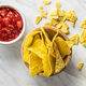 Tortilla chips and red tomato salsa dip. Mexican nacho chips. - PhotoDune Item for Sale