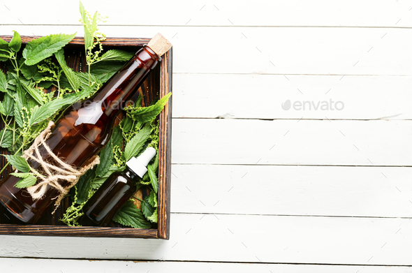 Nettle in herbal medicine - Stock Photo - Images