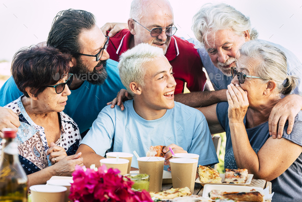Group of mixed generations ages of people have fun together during pizza lunch - Stock Photo - Images