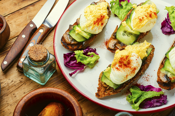 Eggs benedict with stewed mushrooms - Stock Photo - Images