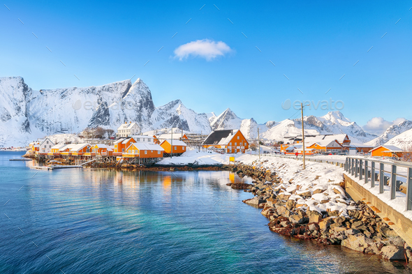 Fabulous winter view of Sakrisoy village and snowy mountaines on background. - Stock Photo - Images